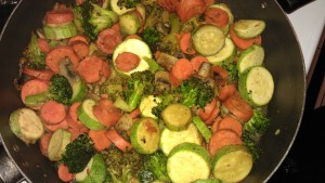 Chunky fresh vegetables in skillet with 2 tbsp coconut oil