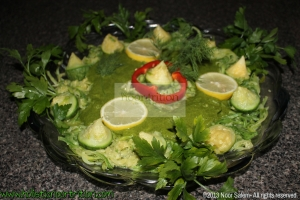 Garnish with lemons, fresh dill, parsley, and red peppers.